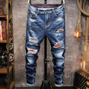 Foreign trade Europe station autumn and winter men's jeans slim personality hole patch elastic small feet casual jeans men