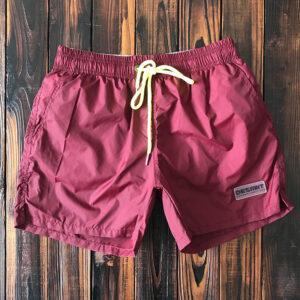 Solid-colored fast dry beach pants men's fitness sports three-point shorts are lined with beach resort hot spring swimming trunks